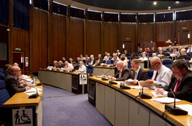 A council meeting in the Council Chamber