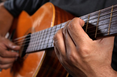 generic image of guitar being played