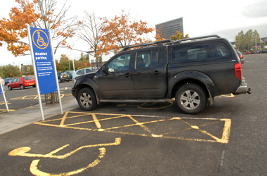 large 4x4 vehicle parked in disabled only parking bay