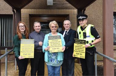 Liz-Anne Handibode, Consumer and Trading Standards, residents Tommy Crawford and Margaret Henderson, John Doyle, East Kilbride Crime Prevention Panel and Constable Greg Roberton, Police Scotland