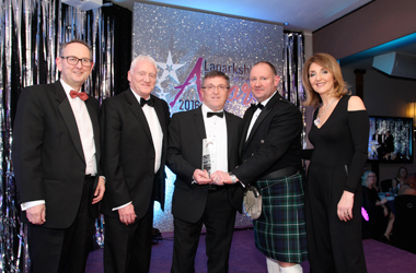 Winners of the Excellence in Innovation Award 2016, The Electric Heating Company receiving their trophy from TV presenter Kaye Adams