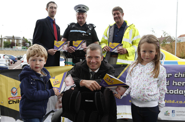 from back row, left to right: Team Leader Fraser Watt from Tesco, Constable Colin Baird and Derek Bavaird from the Good Egg Guide team. Front row, Chair of South Lanarkshire Council's Road Safety Forum, Councillor Graham Simpson with two children who took