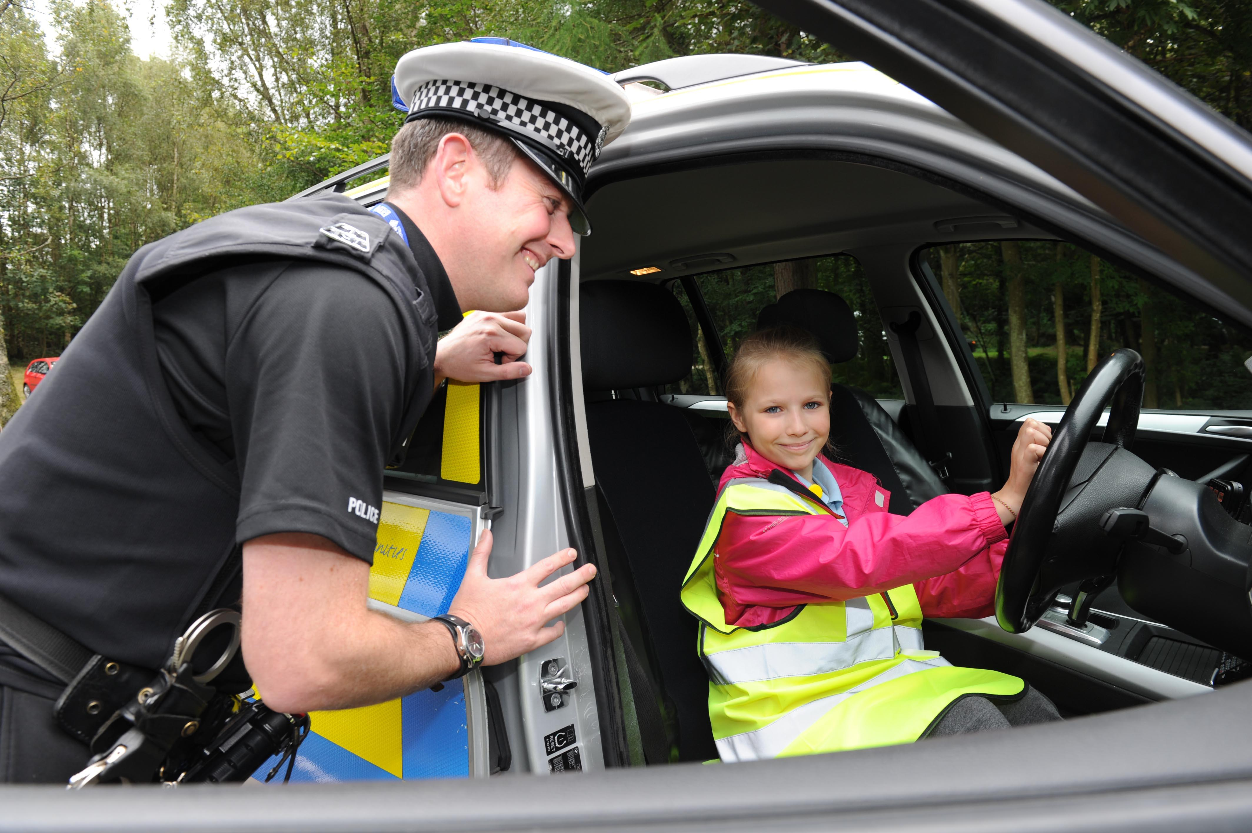 police officer and road safety pupil at JRSO training event