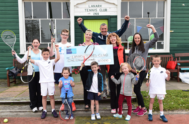 Councillor Catherine McClymont, Chair of the Clydesdale Area Committee presents £1000 community grant to Lanark Tennis Club members young and old