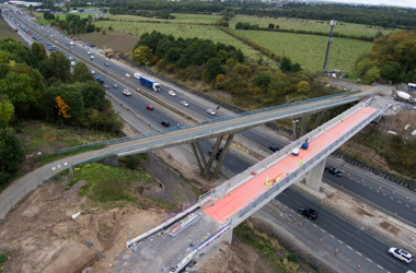 Aerial view of old and new Bothwellpark Road Bridge over the M74