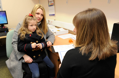 Parent and child enrolling for primary school