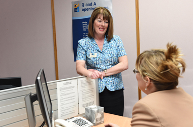Customer Service Assistant helping local resident at Q and A office