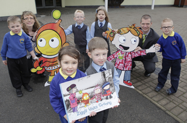 Councillor Simpson with Law PS deputy head teacher, Ann Jessimer, and early years and P1 pupils with road safety mascots
