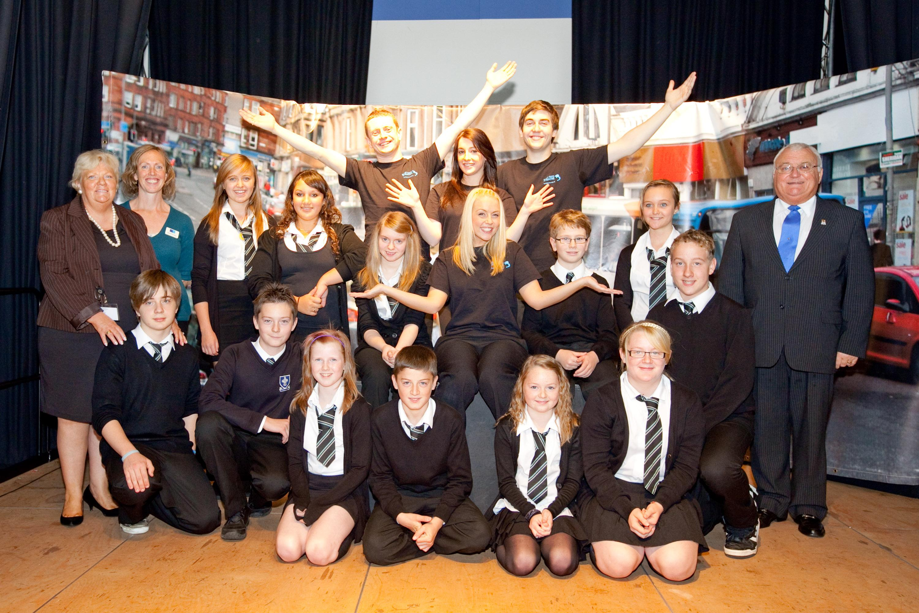 Chair of the council's Road Safety Forum Councillor John Murray and Road Safety Training Officer Sharon O'Leary with members of the Baldy Bane Theatre Company and pupils and teachers from Holy Cross High School