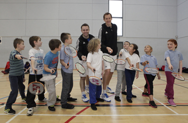 two times Scottish Doubles Champions Jamie Neil and Keith Turnbull with primary school pupils at the Badminton Festival at the Alistair McCoist Centre in East Kilbride