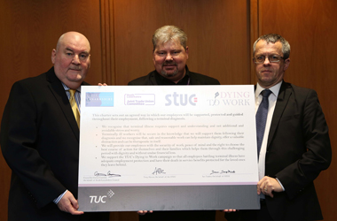 Councillor Gerry Convery, Tony Slaven from Unison and Ian Tasker from the STUC with the signed Dying to Work charter