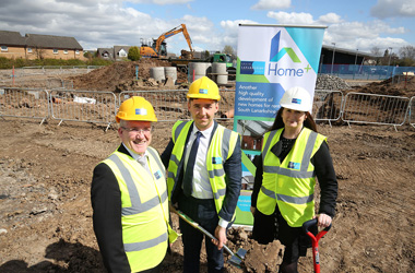 Ceremonial start: Cutting the traditional first sod at the St Blane's development is Councillor Josh Wilson (centre), Chair of Housing and Technical Resources, watched by Executive Director Daniel Lowe and Head of Housing Services Annette Finnan