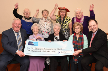 Members of St Brides' Afternoon Club getting £600 community grant cheque from Cambuslang and Rutherglen Area Committee's chair Russell Clearie and depute Richard Tullet