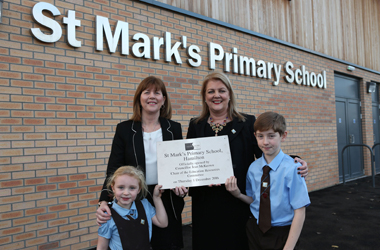 official opening of St Mark's Primary School - two pupils outside school with Head Teacher Mrs Caroline Campbell and Councillor Jean McKeown, the chair of the council's Education Resources Committee