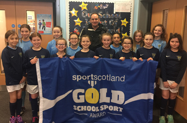 St Mary's Primary School pupils and staff with their gold award from SportScotland