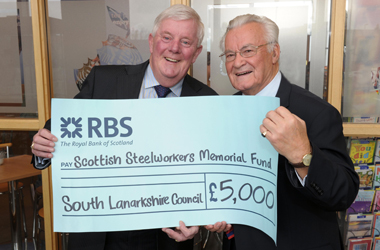Councillor Russell Clearie hands over £5000 cheque to Gilbert Cox of Scottish Steelworkers Memorial Fund