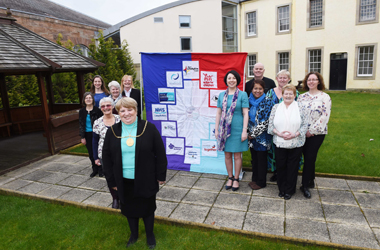 A wall hanging, made by a small group of Lanarkshire carers, has been officially unveiled at Hamilton's Low Park's Museum.