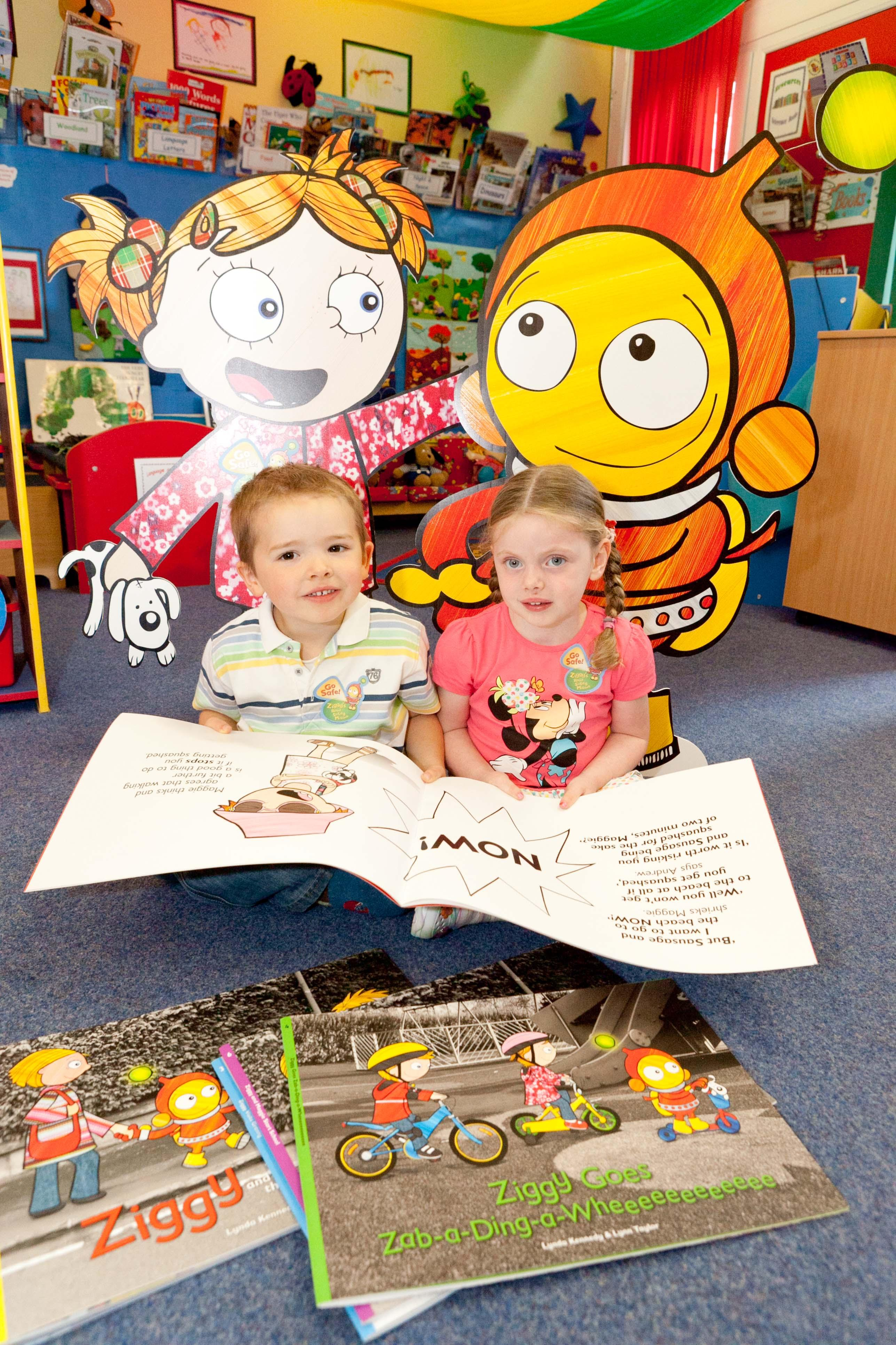 two children with Ziggy road safety information
