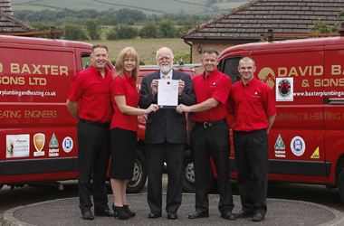 Councillor Hamish Stewart presents Buy with Confidence certificate to David Baxter & Sons Ltd's Philip, David and Lynn Baxter