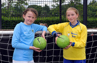 two of the primary school girls taking part in Girls Football Festival 2017