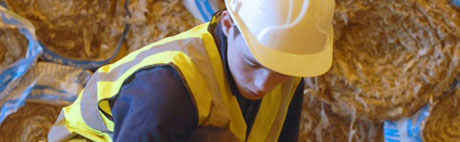 Workman laying loft insulation