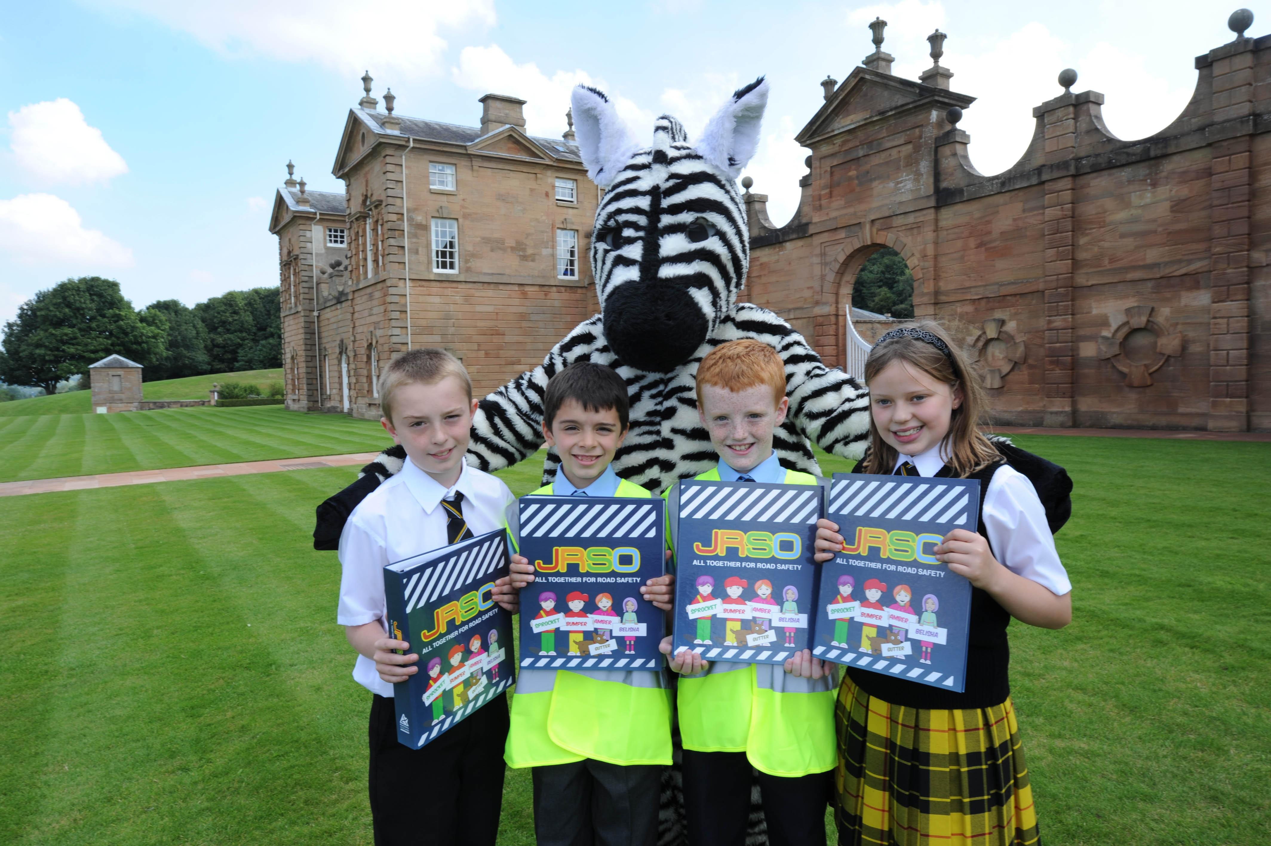 Junior Road Safety primary pupils outside Chatelherault lodge with road safety zebra Zimba
