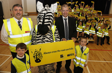 Brian Gallacher of logistics company Norbert Dentressangle, Zimbar the Road Safety Zebra and Chair of South Lanarkshire Council's Road Safety Forum, Councillor Graham Simpson with pupils from Townhill PS, Hamilton
