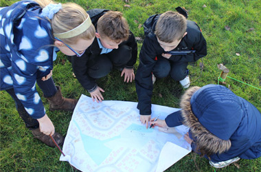 children looking at new maps highlighting walking and cycling routes across South Lanarkshire