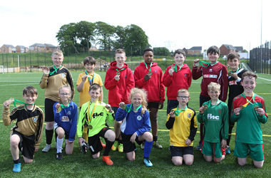 Player from each team taking part in the 2018 Bobby Murdoch Primary Schools Memorial Cup
