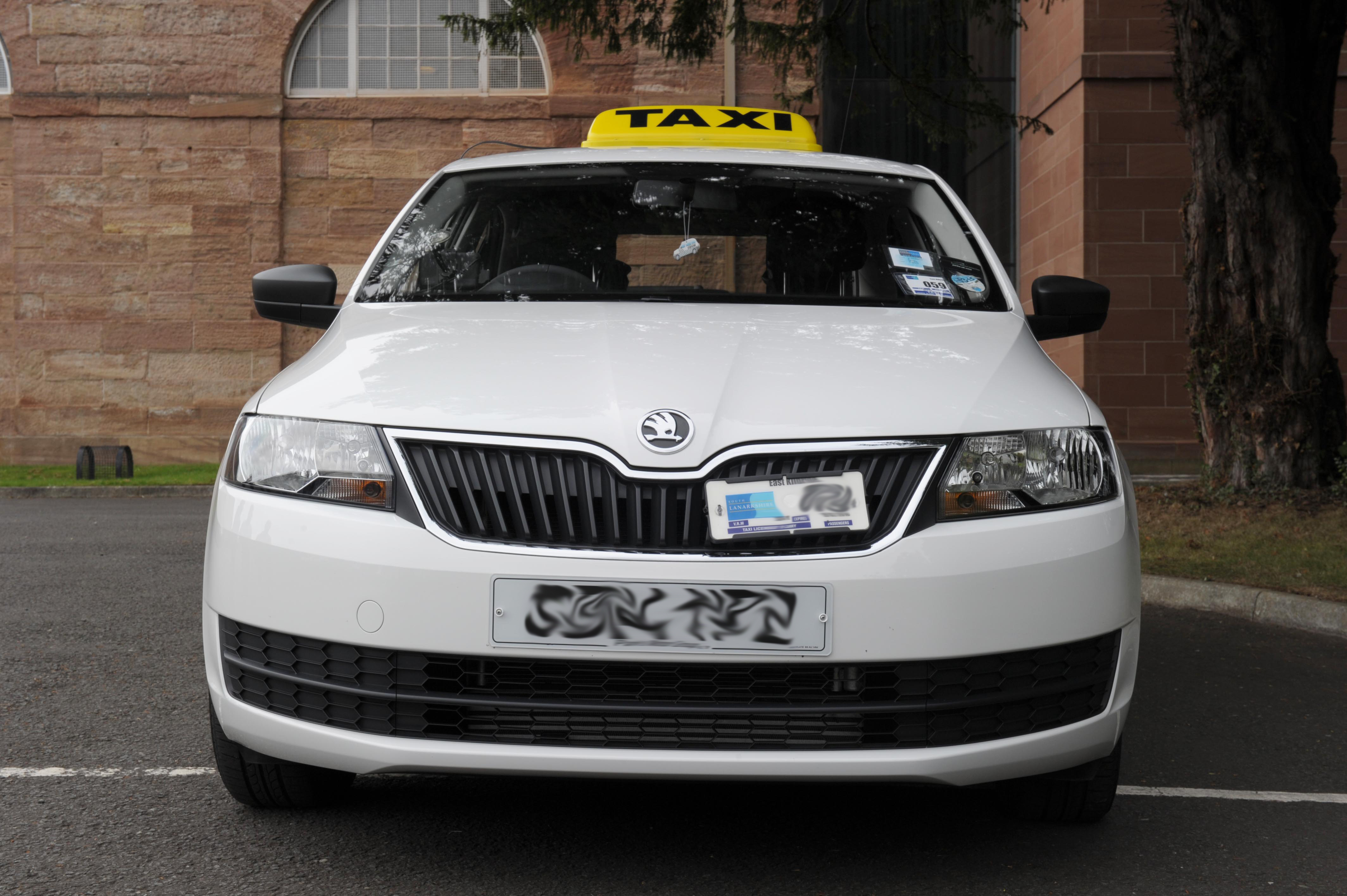 Taxi with roof sign and front plate